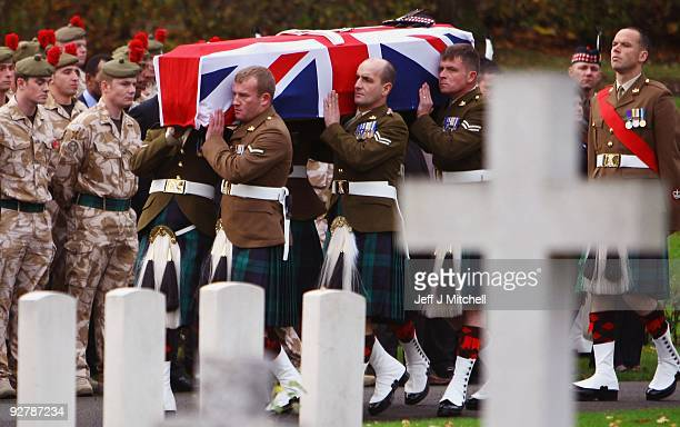 The coffin of Corporal Thomas Mason is carried into Douglas Bank Cemetery on November 5 2009 in Cowdenbeath Scotland Corporal Mason 27 was serving...