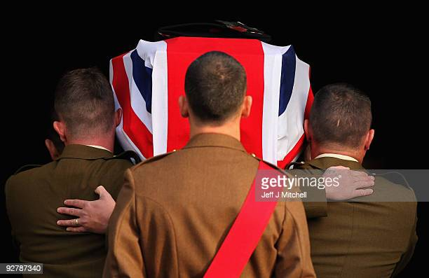 The coffin of Corporal Thomas Mason is carried into Trinity Parish Church on November 5 2009 in Cowdenbeath in Scotland Corporal Mason 27 was serving...
