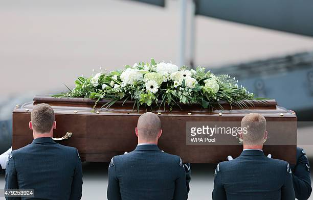 The coffin of David Thompson is taken from the RAF C17 aircraft after it landed at RAF Brize Norton carrying nine of the victims of last Friday's...