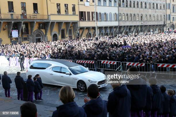 The coffin of Davide Astori arrives by hearse before being carried into Santa Croce church ahead of a funeral service on March 8 2018 in Florence...