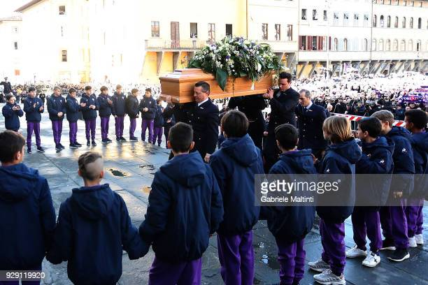 The coffin of Davide Astori is carried into Santa Croce church ahead of a funeral service on March 8 2018 in Florence Italy The Fiorentina captain...