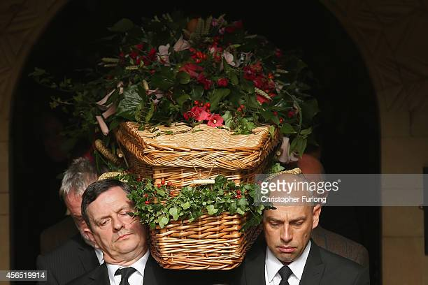 The coffin of Deborah Dowager Duchess of Devonshire is carried out of St Peters Church Edensor on October 2 2014 in Chatsworth England Deborah...
