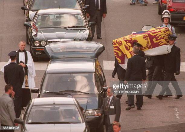 The coffin of Diana Princess of Wales draped in the Royal Standard is carried out of the Pitie Salpetriere hospital in Paris 31 August where she died...