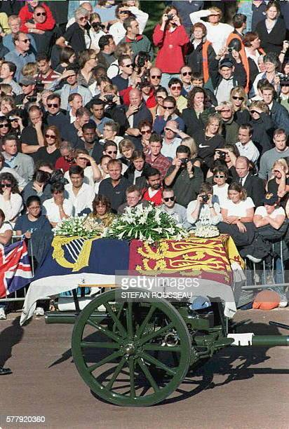 The coffin of Diana Princess of Wales lies on a gun carriage as it passes Hyde Park on its way to Westminster Abbey 06 September ROUSSEAU