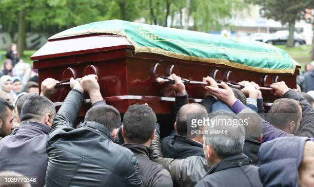 The coffin of Diren Dede is carried during a funeral in Hamburg Germany 04 May 2014 Diren was an exchange student in Missoula Montana USA and was...