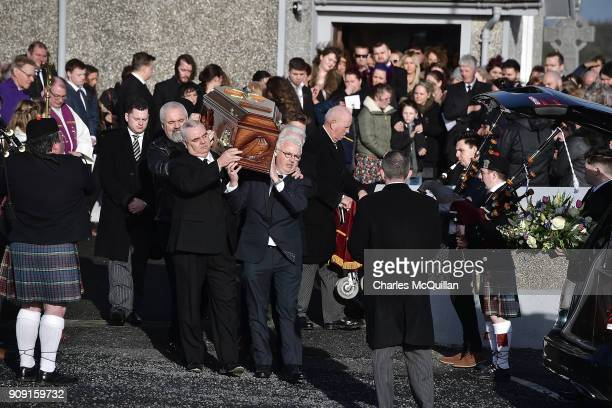 The coffin of Dolores O'Riordan accompanied by pipers is carried out of St Ailbe's parish church in Ballybricken after the funeral on January 23 2018...