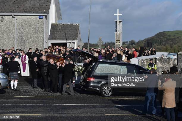 The coffin of Dolores O'Riordan accompanied by pipers is carried out of St Ailbe's parish church in Ballybricken after Dolores O'Riordan's funeral on...