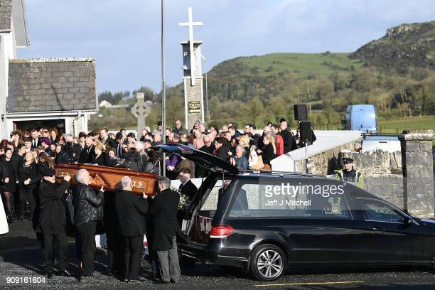 The coffin of Dolores O'Riordan is carried out of St Ailbe's parish church in Ballybricken after Dolores O'Riordan's funeral on January 23 2018 in...