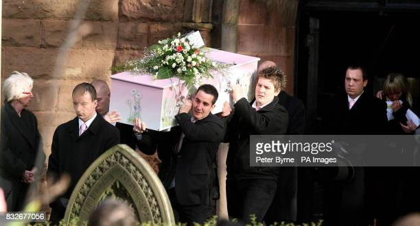 The coffin of Ellie Lawrenson is carried by father Darren Lawrenson and her uncle Kiel Simpson at Eccleston Christ Church St Helens Merseyside