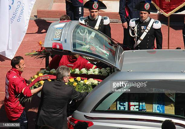 The coffin of footballer Piermario Morosini is carried by hearse through Armando Picchi Stadium where AS Livorno players and supporters pay their...