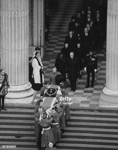The coffin of former British Prime Minister Winston Churchill is carried out of St Paul's Cathedral after the funeral service London 30th January...