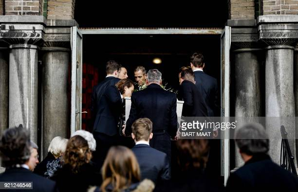 The coffin of former Dutch Prime Minister Ruud Lubbers is carried into the Laurentius and Elisabeth Cathedral in Rotterdam during his funeral on...