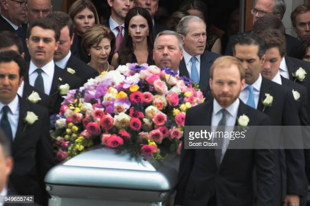 The coffin of former first lady Barbara Bush is carried from St Martin's Episcopal Church following her funeral service as her son former president...