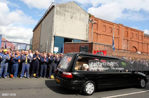 The coffin of former Glasgow shipyard union leader Jimmy Reid passes workers who lined the streets outside Govan Ship yard on its way to Govan Old...
