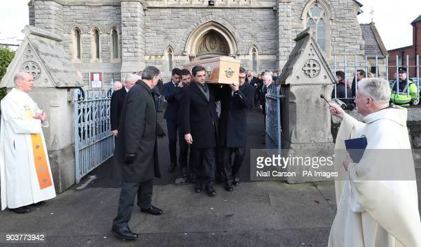The coffin of former Irish attorney general leading businessman and international statesman Peter Sutherland is taken from the Church of the Sacred...