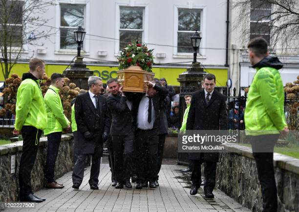The coffin of former Manchester United and Northern Ireland goalkeeper Harry Gregg arrives at St Patrick's Parsh Church on February 21 2020 in...