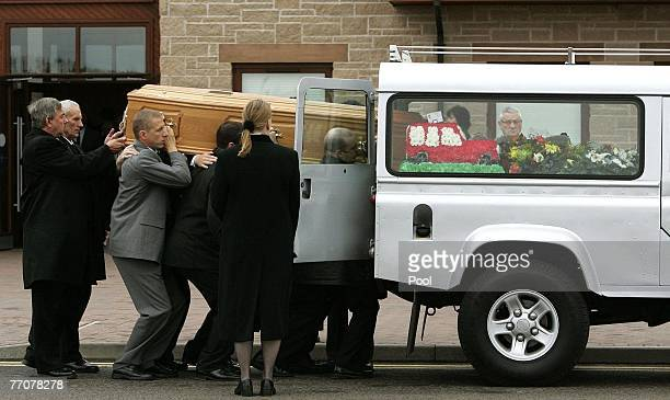 The coffin of former quad bike champion Graeme Duncan is carried to a waiting hearse following his funeral on September 28 2007 in Edinburgh Scotland...