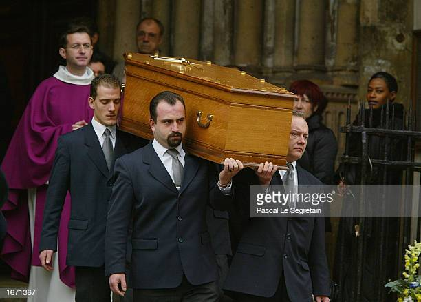 The coffin of French actor Daniel Gelin leaves the Church of St Germain Des Pres after his funeral services December 4 2002 in Paris Gelin known best...