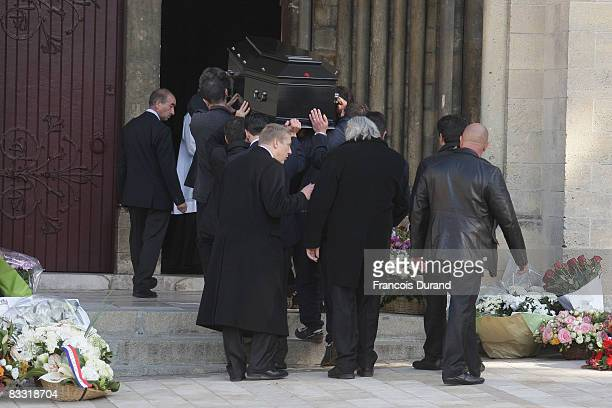 The coffin of French actor Guillaume Depardieu is carried into Notre Dame Church before the funeral service on October 17, 2008 in Bougival, France.