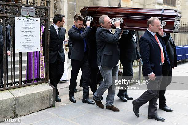 The coffin of French competitive sailor Florence Arthaud is carried after the funeral service at Saint Severin Church on March 30 2015 in Paris...