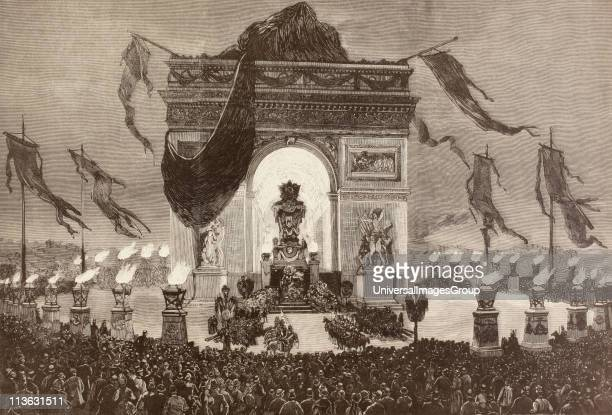 The coffin of French writer Victor Hugo is displayed beneath the Arc de Triomphe Paris France during his funeral rites on the night of May 31 1885...