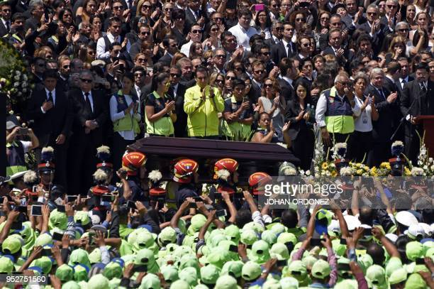 The coffin of Guatemala City Mayor and former Guatemalan President Alvaro Arzu is escorted by military personnel during his funeral as they arrive to...