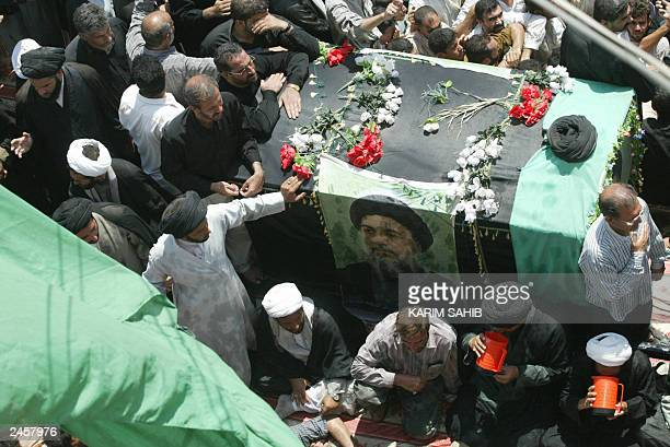 The coffin of Iraq's Ayatollah Mohammad Baqer alHakim arrives at the Imam Ali shrine in Najaf 02 September 2003 A sea of mourners flooded the streets...