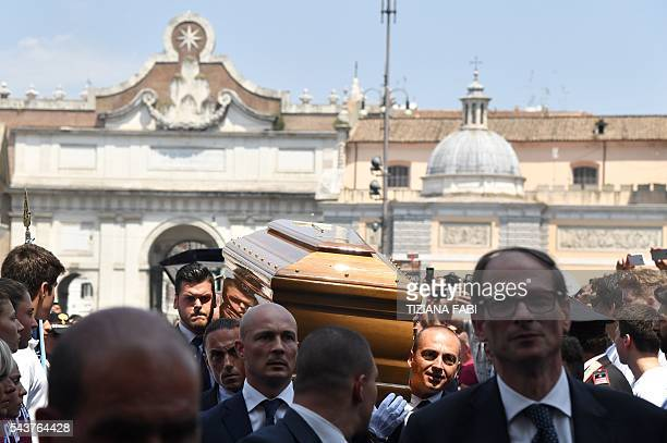 The coffin of Italian actor Bud Spencer born Carlo Pedersoli is carried inside the church of the artists Santa Maria in Montesanto on June 30 2016...