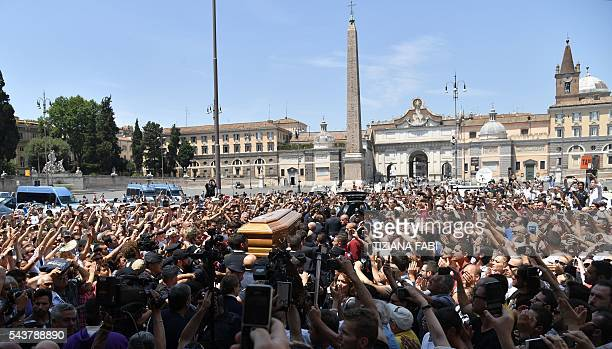 The coffin of Italian actor Bud Spencer born Carlo Pedersoli is carried outside the church of the artists Santa Maria in Montesanto on June 30 2016...
