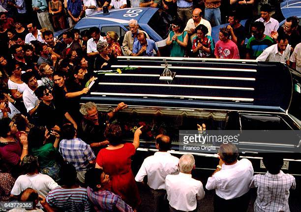 The coffin of Italian judge Paolo Borsellino is carried thoughout the crowd during his funerals at the Palermo Cathedral on July 24 1992 in Palermo...