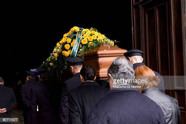 The coffin of Italian Poetess Alda Merini is carried in the Milan Cathedral on November 4 2009 in Milan Italy Poetess Alda Merini who was considered...