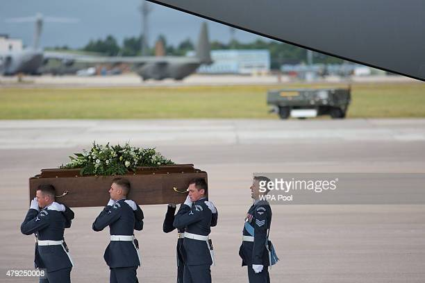 The coffin of James McQuire is taken from the RAF C17 aircraft after it landed at RAF Brize Norton carrying nine of the victims of last Friday's...