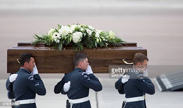 The coffin of Janet Stocker is taken from the RAF C17 aircraft after it landed at RAF Brize Norton carrying nine of the victims of last Friday's...