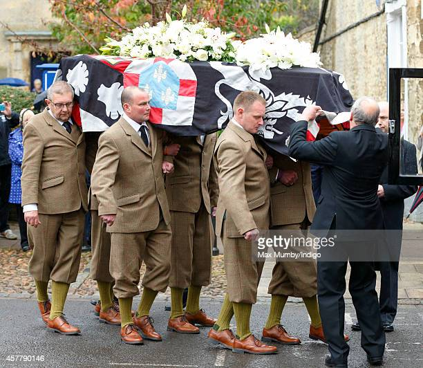 The coffin of John SpencerChurchill 11th Duke of Marlborough leaves the church of St Mary Magdalene after his funeral on October 24 2014 in Woodstock...