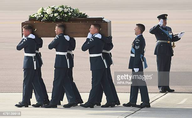 The coffin of John Stollery one of the victims of last Friday's terrorist attack is taken from the RAF C17 aircraft at RAF Brize Norton in Tunisia on...