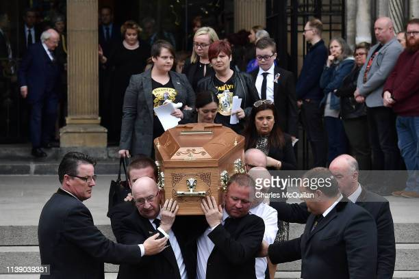 The coffin of journalist Lyra McKee is taken out of the church after the funeral as Lyra McKee's partner Sara Canning follows the coffin at St Anne's...