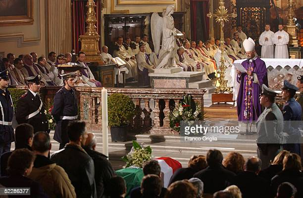 The coffin of killed Italian intelligence officer Nicola Calipari stands at Santa Maria Degli Angeli Basilica during the State funeral on March 7,...