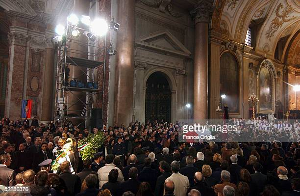 The coffin of killed Italian intelligence officer Nicola Calipari is carried through Santa Maria Degli Angeli Basilica during the State funeral on...