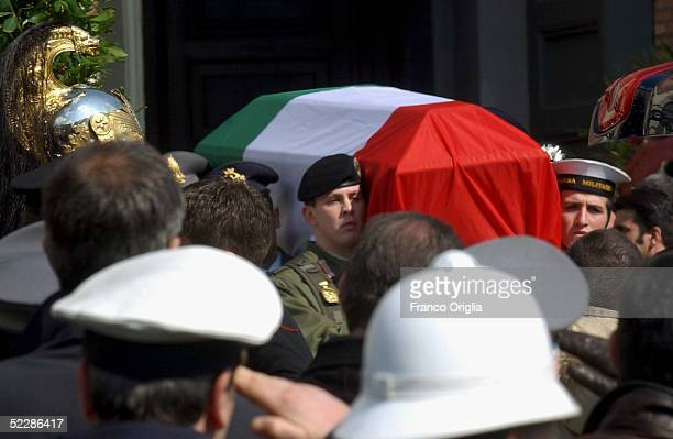 The coffin of killed Italian intelligence officer Nicola Calipari is carried out from Santa Maria Degli Angeli Basilica during the State funeral on...
