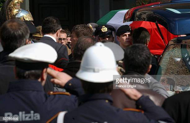 The coffin of killed Italian intelligence officer Nicola Calipari leaves Santa Maria Degli Angeli Basilica during the State funeral on March 7, 2005...