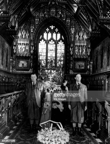 The coffin of King George VI, draped in a Royal Standard and guarded by workers from the Sandringham estate, in the little Church of St Mary...