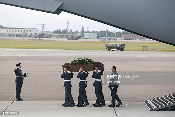 The coffin of Lisa Graham is taken from the RAF C17 aircraft after it landed at RAF Brize Norton carrying nine of the victims of last Friday's...
