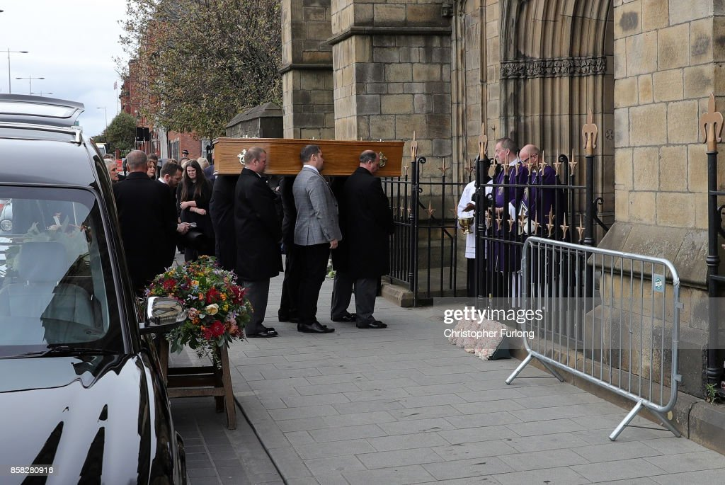 The coffin of Liz Dawn is carried into Salford Cathedral on October 6, 2017 in Salford, England. Actress Liz Dawn who died aged 77, played Vera Duckworth in Coronation Street for 34 years. She was diagnosed with lung disease emphysema and was written out of the show in 2008 at her own request.
