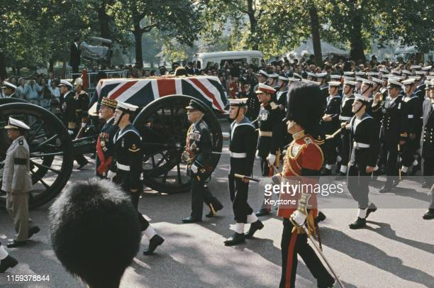 The coffin of Lord Louis Mountbatten is carried through London on a gun carriage accompanied by Royal Navy ratings at his funeral 5th September 1979...