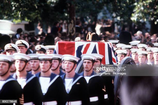 The coffin of Lord Mountbatten on a guncarriage is drawn by Naval ratings along The Mall during the procession to Westminster Abbey