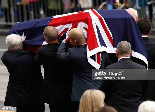 The coffin of Lou Richards is carried to the procession during the former Collingwood legend Lou Richards state funeral at St Paul's Cathedral on May...