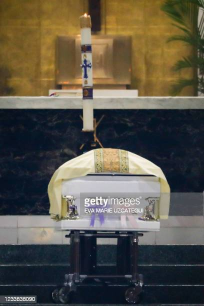 The coffin of Lucia and Emma Guara, killed when the 12-story Champlain Towers South crumbled over a week ago, is seen at St. Joseph Catholic Church...