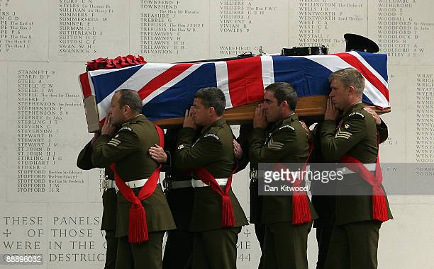 The coffin of Maj Sean Birchall is taken into Guards Chapel during his funeral on July 8, 2009 in London, England. Maj Birchall of 1st Battalion...