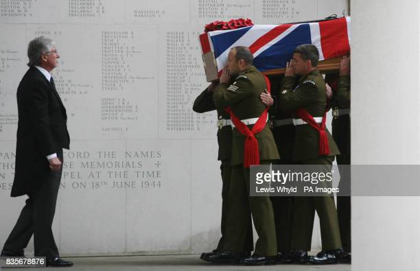 The coffin of Major Sean Birchall of the 1st Battalion Welsh Guards is carried into Guards Chapel London for his funeral service