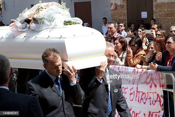 The coffin of Melissa Bassi arrives at the church during the funeral on May 21, 2012 in Mesagne. Italian authorities searched the same day for a...